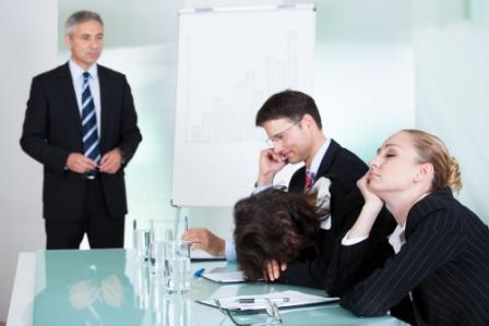 sleeping business people in meeting
